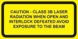 "IEC Class 3B  Defeatably interlocked  protective housing label (2""w x 1""h)"